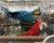 Mláďata ary ararauny a ary zelenokřídlého v miniaturní kleci. I tak vypadala burza v Reggiu Emilia. (Foto: Jan Potůček, Ararauna.cz)
